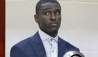 Boston Celtics guard Jabari Bird appears for his arraignment on domestic violence charges at Brighton Municipal Court, Thursday, Sept. 13, 2018 in Boston.  Prosecutors say Bird choked his girlfriend multiple times, kicked her and prevented her from leaving his apartment for hours last week before he collapsed in distress.(Angela Rowlings /The Boston Herald via AP, Pool)