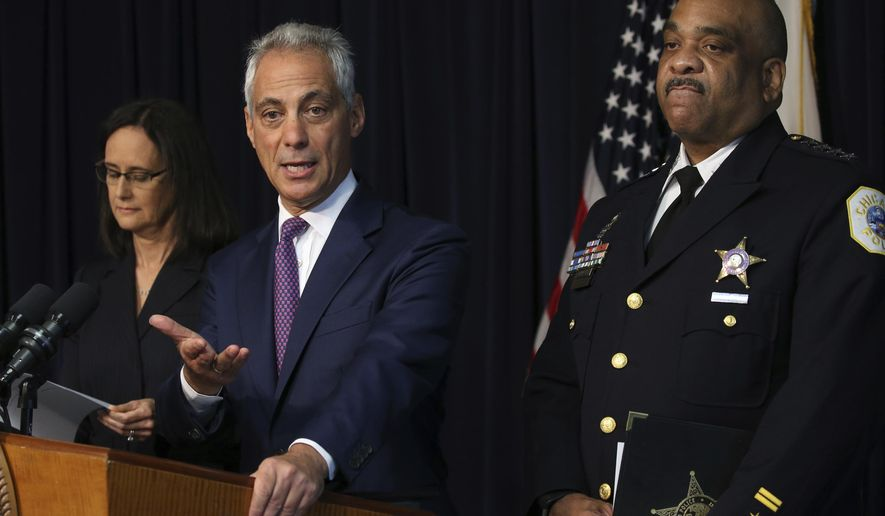 Chicago mayor Rahm Emanuel flanked by Chicago police Superintendent Eddie Johnson and Attorney General Lisa Madigan, announce that they have filed a proposed consent decree in federal court to reform the Chicago Police Department, during a news conference, Thursday, Sept. 13, 2918 in Chicago. The 226-page document was submitted Thursday to a Chicago federal judge.   (Antonio Perez /Chicago Tribune via AP)