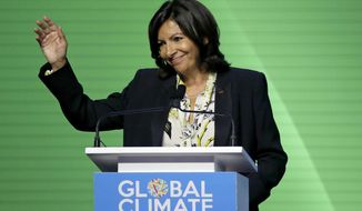 Mayor of Paris Anne Hidalgo waves after speaking during the opening plenary of the Global Action Climate Summit Thursday, Sept. 13, 2018, in San Francisco. The mayor of Paris and other top officials who were instrumental in securing the 2015 U.N. climate accord opened the California summit by talking about the importance of continuing the path to clean energy, despite President Donald Trump's withdrawal of the United States from the pact. (AP Photo/Eric Risberg)