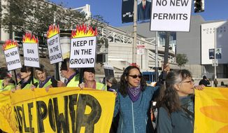 "Members of the group 1000 Grandmothers protest outside the Moscone Center in San Francisco where the Global Climate Action Summit is being held, on Thursday, Sept. 13, 2018. The group, which says it is made up of elder women activists working to address the climate crisis, chanted ""Listen to your Grandma, no more fracking!"" (AP Photo/Juliet Williams)"