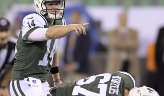 FILE - In this Aug. 24, 2018, file photo, New York Jets quarterback Sam Darnold (14) calls an audible at the line of scrimmage during the team's NFL football game against the New York Giants in East Rutherford, N.J. New York's rookie quarterback will play against the Mismi Dolphins on Sunday at MetLife Stadium. (AP Photo/Bill Kostroun, File)