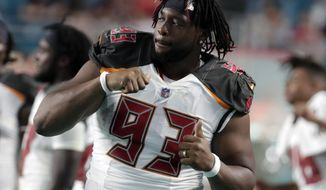FILE - In this Aug. 9, 2018, file photo, Tampa Bay Buccaneers defensive tackle Gerald McCoy (93) dances on the sidelines, during the second half of an NFL preseason football game against the Miami Dolphins in Miami Gardens, Fla. McCoy is puzzled when he hears people question the ability of fellow NFL players, particularly backup quarterbacks such as Nick Foles and Ryan Fitzpatrick. ``It's the NFL,'' Tampa Bay's six-time Pro Bowl defensive tackle said. ``Everybody's good.'' (AP Photo/Lynne Sladky, File)