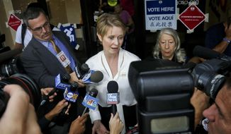 "New York gubernatorial candidate Cynthia Nixon, center, speaks to members of the media outside a polling station after voting in the primary, Thursday, Sept. 13, 2018, in New York. Democrats across New York state are picking the winner of a long and sometimes nasty primary contest between Gov. Andrew Cuomo and activist and former ""Sex and the City"" star Nixon. (AP Photo/Bebeto Matthews)"