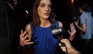 Julia Salazar, answers questions during an interview after winning the Democratic primary over Martin Dilan in New York's 18th State Senate district race, Thursday, Sept. 13, 2018, in New York. (AP Photo/Julie Jacobson)