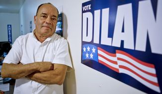 In this Aug. 30, 2018, photo, New York State Sen. Martin Dilan, a Democrat for Brooklyn's 18th senate district, pose in his campaign headquarters in New York. Julia Salazar is taking on the 16-year-incumbent Dilan. (AP Photo/Bebeto Matthews)