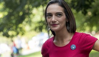 FILE - In this Aug. 15, 2018, file photo, Democratic New York state Senate candidate Julia Salazar smiles as she speaks to a supporter before a rally in McCarren Park in the Brooklyn borough of New York. Salazar is taking on 16-year-incumbent Sen. Martin Dilan in Brooklyn's 18th District. (AP Photo/Mary Altaffer, File)
