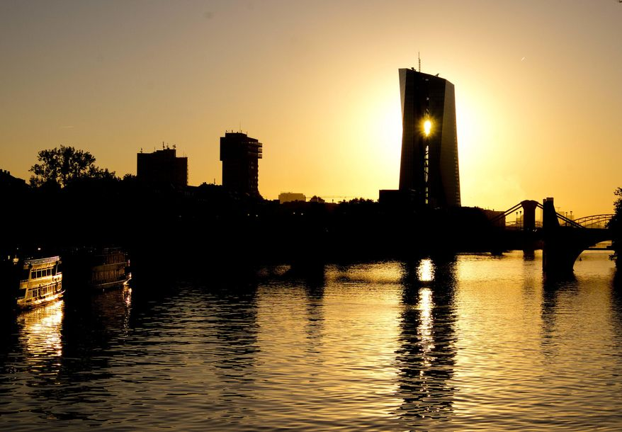 The sun rises behind the European Central Bank in Frankfurt, Germany, Wednesday, Sept.12, 2018. The governing council of the ECB will meet on Thursday. (AP Photo/Michael Probst)