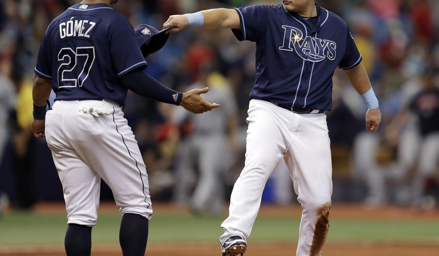 Tampa Bay Rays' Ji-Man Choi, of South Korea, celebrates with Carlos Gomez after the Rays defeated the Cleveland Indians 3-1 during a baseball game Wednesday, Sept. 12, 2018, in St. Petersburg, Fla. (AP Photo/Chris O'Meara)