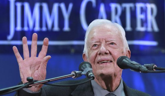 Former President Jimmy Carter, 93, answers questions from students during his annual town hall with Emory University freshmen in the campus gym on Wednesday, Sept 12, 2018, in Atlanta. Speaking at his presidential center in Atlanta on Tuesday, Carter said U.S. policies on immigration, the environment and human rights will not improve while Trump is in office. (Curtis Compton/Atlanta Journal-Constitution via AP)