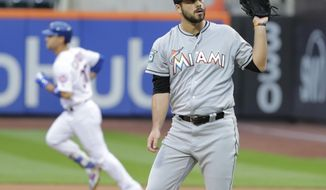 Miami Marlins relief pitcher Kyle Barraclough, right, reacts as New York Mets' Michael Conforto (30) runs the bases after hitting a home run during the ninth inning of the first baseball game of a doubleheader Thursday, Sept. 13, 2018, in New York. (AP Photo/Frank Franklin II) ** FILE **