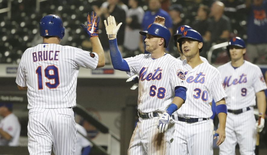 New York Mets' Jay Bruce (19) celebrates with teammates Jeff McNeil (68) and Michael Conforto (30) after hitting a grand slam home run during the sixth inning of a baseball game against the Miami Marlins Wednesday, Sept. 12, 2018, in New York. (AP Photo/Frank Franklin II)