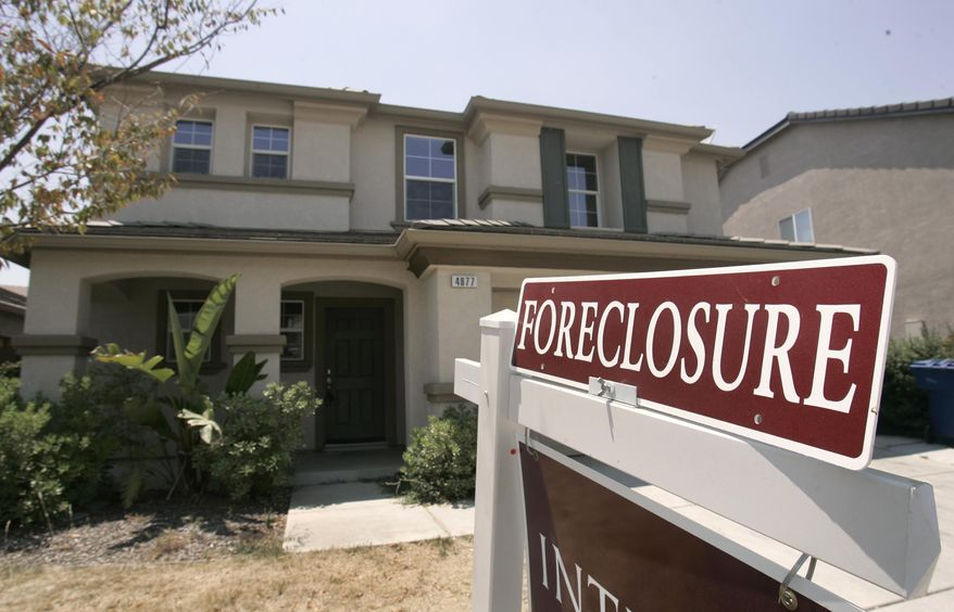 FILE- This July 2, 2008, file photo shows a foreclosed home in Sacramento, Calif. As home values plummeted after the housing bubble burst in 2007, many borrowers with exotic types of loans were stuck, unable to refinance as lenders began to tighten their lending criteria. That set the stage for cascading mortgage defaults. (AP Photo/Rich Pedroncelli, File)