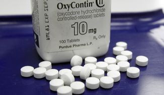 FILE - This Feb. 19, 2013, file photo shows OxyContin pills arranged for a photo at a pharmacy in Montpelier, Vt. Oregon's attorney general has sued the pharmaceutical company that makes OxyContin, saying it misrepresented the risks and benefits of the drug and lied to a state regulatory agency to maximize profits. (AP Photo/Toby Talbot, File)