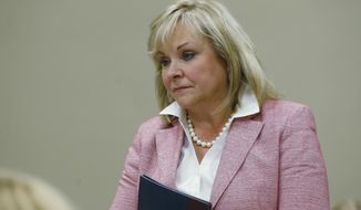 FILE - In this July 30, 2018, Oklahoma Gov. Mary Fallin listens during a meeting in Oklahoma City. Fallin and Cherokee Nation Principal Chief Bill John Baker have announced a council to study the expansion of poultry operations in northeastern Oklahoma. (AP Photo/Sue Ogrocki, File)