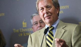 FILE - In this Sept. 3, 2015, file photo, Bruce Harreld speaks to media after he was introduced as the new University of Iowa president during a news conference in Iowa City, Iowa. The university has agreed to pay $55,000 to settle a lawsuit alleging that its 2015 presidential search violated the open meetings law. The university doesn't admit any violations in the settlement, which was made public Wednesday, Sept. 12, 2018. But Iowa has agreed to abide by several transparency measures during future presidential searches. (David Scrivner/Iowa City Press-Citizen via AP, File)