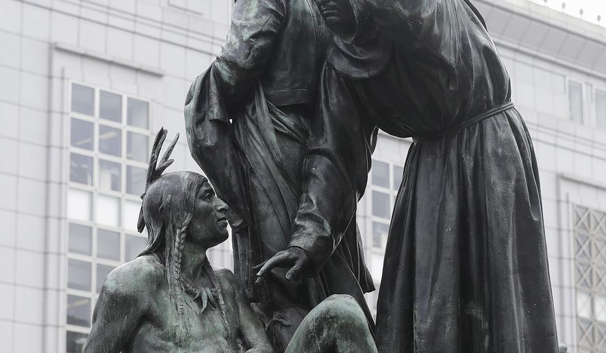 """FILE - This Friday, March 2, 2018 file photo shows a statue that depicts a Native American at the feet of a Spanish cowboy and Catholic missionary in San Francisco. A San Francisco board has decided to remove the 19th-century statue that activists say is racist and demeaning to indigenous people. The San Francisco Board of Appeals voted Wednesday, Sept. 12, 2018, on the """"Early Days"""" statue. (AP Photo/Jeff Chiu, File)"""