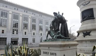 """This March 2, 2018, file photo shows a statue that depicts a Native American at the feet of a Spanish cowboy and Catholic missionary in San Francisco. A San Francisco board has decided to remove the 19th-century statue that activists say is racist and demeaning to indigenous people. The San Francisco Board of Appeals voted Wednesday, Sept. 12, 2018, on the """"Early Days"""" statue. (AP Photo/Jeff Chiu, File)"""