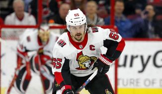In this Jan. 30, 2018, file photo, Ottawa Senators' Erik Karlsson (65) moves the puck against the Carolina Hurricanes during the first period of an NHL hockey game in Raleigh, N.C. The San Jose Sharks have acquired two-time Norris Trophy-winning defenseman Erik Karlsson from the Senators, the teams announced Thursday, Sept. 13, 2018. (AP Photo/Karl B DeBlaker) **FILE**