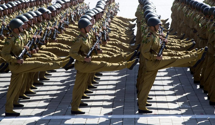 In this Sunday, Sept. 9, 2018, file photo, soldiers march past during a parade for the 70th anniversary of North Korea's founding day in Pyongyang, North Korea. North Korea staged a major military parade, huge rallies and will revive its iconic mass games on Sunday to mark its 70th anniversary as a nation. (AP Photo/Ng Han Guan, File)