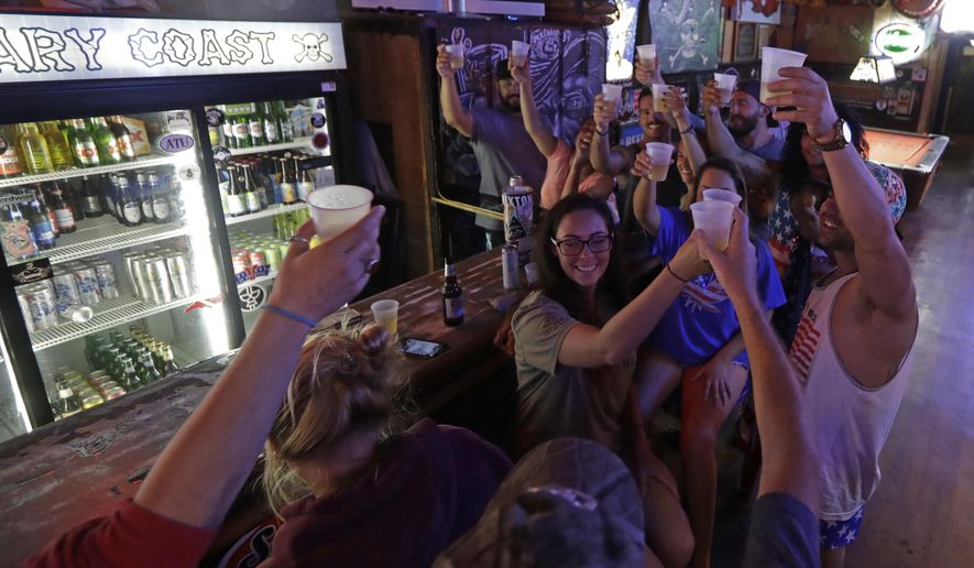 Locals riding out the storm toasted Hurricane Florence on Thursday at the Barbary Coast bar in downtown Wilmington, North Carolina. (Associated Press)