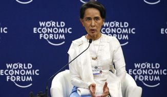 Aung San Suu Kyi, the State Counsellor of Myanmar, gestures during a one-on-one discussion at the World Economic Forum's meeting at the National Convention Center Thursday, Sept. 13, 2018, in Hanoi, Vietnam. Suu Kyi says the country's handling of its Rohingya Muslim minority crisis could have been handled better. (AP Photo/Bullit Marquez)