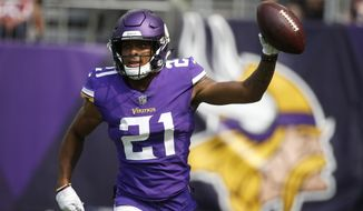 FILE - In this Sept. 9, 2018, file photo, Minnesota Vikings cornerback Mike Hughes celebrates after returning an interception 28-yards for a touchdown during the second half of an NFL football game against the San Francisco 49ers, in Minneapolis. Hughes was forced into a heavy role in his NFL debut by injuries in Minnesota's secondary, and this week the rookie has been preparing to face Green Bay quarterback Aaron Rodgers. There's no easing in for this first-round draft pick. (AP Photo/Bruce Kluckhohn, File)