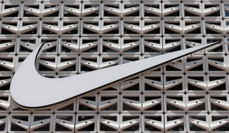 FILE - This Aug. 8, 2017, file photo shows the Nike logo at a store in Miami Beach, Fla. Walmart-owned Jet.com will soon sell Nike products on its site as it seeks to catch up with Amazon ahead of the holiday shopping season. (AP Photo/Alan Diaz, File)