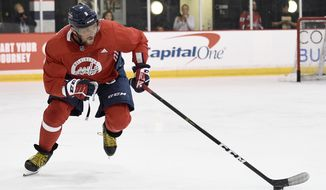 Washington Capitals left wing Alex Ovechkin, of Russia, skates with the puck during NHL hockey training camp, Friday, Sept. 14, 2018, in Arlington, Va. (AP Photo/Nick Wass) ** FILE **