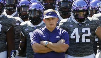 FILE - In this Saturday, Sept. 1, 2018, file photo, TCU head coach Gary Patterson stands with his team before playing Southern University in an NCAA college football game in Fort Worth, Texas. No. 15 TCU gets another chance for the Big 12 against No. 4 Ohio State. The Horned Frogs and Buckeyes will play Saturday night at the home stadium of the NFL's Dallas Cowboys. (AP Photo/Ron Jenkins, File)