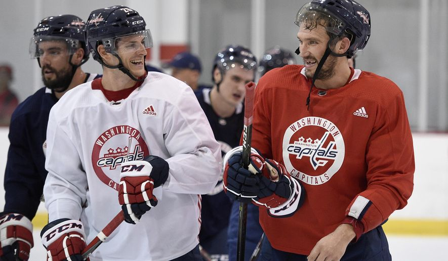 Washington Capitals left wing Alex Ovechkin, right, of Russia, laughs with Nic Dowd, left, as they leave the ice at NHL hockey training camp, Friday, Sept. 14, 2018, in Arlington, Va. (AP Photo/Nick Wass)