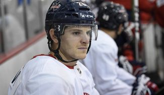 Washington Capitals' Nic Dowd sits on the bench before taking the ice at NHL hockey training camp, Friday, Sept. 14, 2018, in Arlington, Va. (AP Photo/Nick Wass) ** FILE **