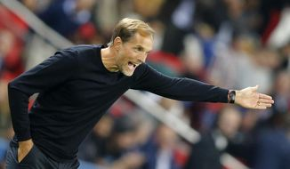 PSG's coach Thomas Tuchel gives directions during their French League One soccer match between Paris-Saint-Germain and Saint-Etienne at the Parc des Princes stadium in Paris, Friday, Sept. 14, 2018. (AP Photo/Michel Euler)