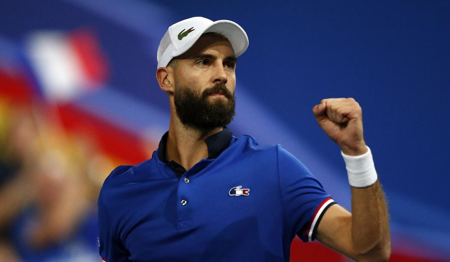 France's Benoit Paire reacts as he plays Spain's Pablo Carreno Busta during the Davis Cup semifinals France against Spain, Friday, Sept.14, 2018 in Lille, northern France. (AP Photo/Michel Spingler)