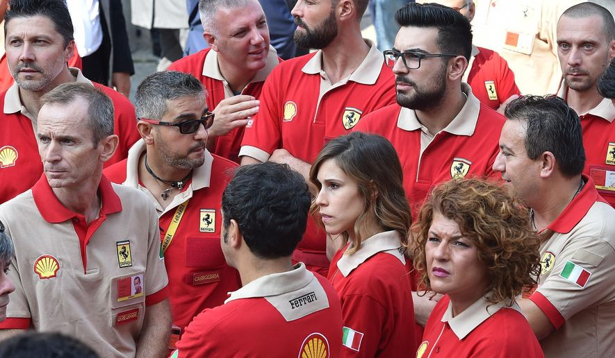 "Ferrari workers attend a commemorative Mass for late CEO Sergio Marchionne in Turin's cathedral, Italy, Friday, Sept. 14, 2018. The heir to Fiat's founding family, John Elkann, has paid an emotional farewell to the late CEO Sergio Marchionne, who died suddenly in July, saying ""he taught all of us ... to have the courage to change."" (Alessandro Di Marco/ANSA via AP)"