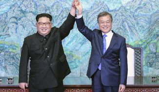 FILE - In this April 27, 2018 file photo, North Korean leader Kim Jong Un, left, and South Korean President Moon Jae-in raise their hands after signing a joint statement at the border village of Panmunjom in the Demilitarized Zone, South Korea. President Moon faces his toughest challenge yet in his third summit with Kim in Pyongyang, where he will be pressed to deliver substantive agreements beyond the vague aspirational statements on denuclearization that have been repeated in past months. (Korea Summit Press Pool via AP, File)