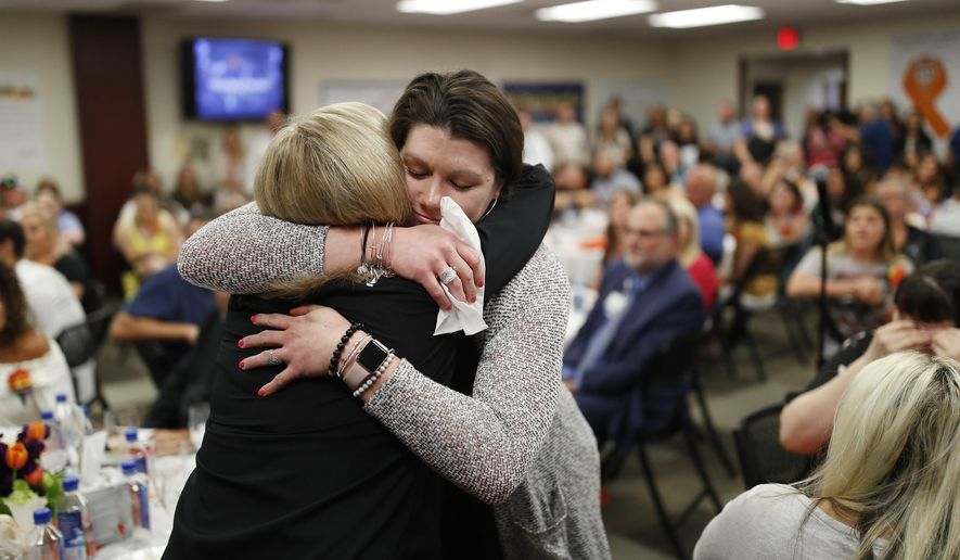 Amanda Peterson, right, embraces nurse Marlena Ryan during a reunion event for victims of the Oct. 1 shooting and their health care providers at Sunrise Hospital, Friday, Sept. 14, 2018, in Las Vegas. Ryan helped take care of Peterson after she was injured in the mass shooting. (AP Photo/John Locher)