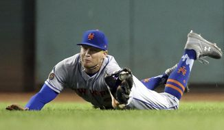 New York Mets right fielder Brandon Nimmo makes a diving catch of a fly ball by Boston Red Sox's Mookie Betts in the fifth inning of a baseball game at Fenway Park, Friday, Sept. 14, 2018, in Boston. (AP Photo/Elise Amendola)