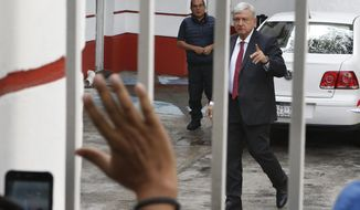 Mexico's President-elect Andres Manuel Lopez Obrador greets supporters as he arrives to his party's headquarters in Mexico City, Thursday, Sept. 13, 2018. Lopez Obrador takes office Dec. 1. (AP Photo/Marco Ugarte)