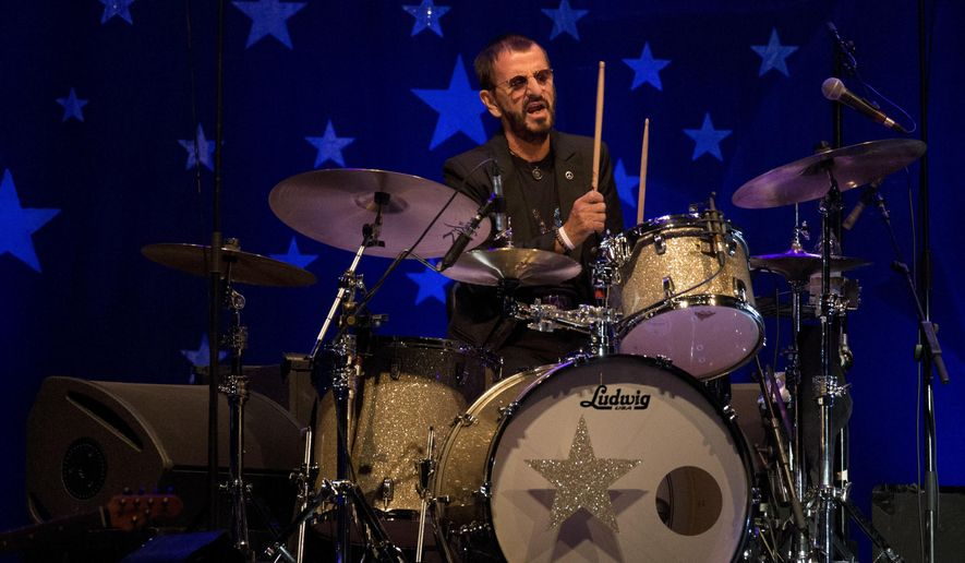 In this June 23, 2018, file photo, musician Ringo Starr performs in Tel Aviv, Israel. Within a week of Paul McCartney playing a surprise show at Grand Central Station, Starr followed a more old-fashioned path Thursday night, Sept. 13, 2018. The 78-year-old drummer and singer headlined a two-hour show at Radio City Music Hall, in New York, with thousands spending much of the performance standing and singing along. (AP Photo/Ariel Schalit, File)