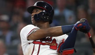 Atlanta Braves left fielder Ronald Acuna Jr. (13) hits triple in the fourth inning of a baseball game against the Washington Nationals Friday, Sept. 14, 2018, in Atlanta. (AP Photo/John Bazemore)