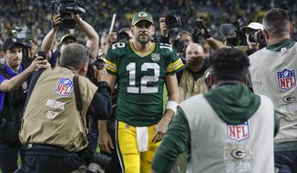 FILE - In this Sept. 9, 2018, file photo, Green Bay Packers' Aaron Rodgers walks off the field after an NFL football game against the Chicago Bears, in Green Bay, Wis. Right up until kickoff, the fans at Lambeau Field will be holding their breath to see if Aaron Rodgers can go against the Minnesota Vikings on Sunday. (AP Photo/Mike Roemer, File)