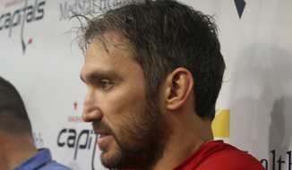 Washington Capitals left wing Alex Ovechkin talks to reporters at the team's media day ahead of the 2018-19 NHL season at MedStar Capitals Iceplex in Arlington, Virginia, on Friday, Sept. 14, 2018. (Adam Zielonka/The Washington Times)