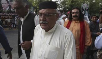 Pakistani politician Mian Iftikhar, center, arrives at a residence of Pakistan's former prime minister Nawaz Sharif to offer condolences for the death of Sharif's wife Kulsoom Nawaz, in Lahore, Pakistan, Thursday, Sept. 13, 2018. Mourners have attended the funeral of the wife of Sharif in London, where she died at a hospital this week after months in critical condition. According to Sharif's family she will be buried in Lahore on Friday. (AP Photo/K.M. Chaudary)