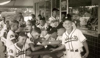 "This image provided by Common Pictures shows the 1955 Orlando Kiwanis little league baseball team. In 1955, one of the most significant games in American history took place in Orlando, Fla, but hardly anyone knows about it. For the first time, an integrated Little League Baseball game, a group of white kids playing a team of African-American youngsters, was held in the Jim Crow South. The new documentary ""Long Time Coming: A 1955 Baseball Story"" has brought this amazing snippet in the American experience back to life. (via AP)"