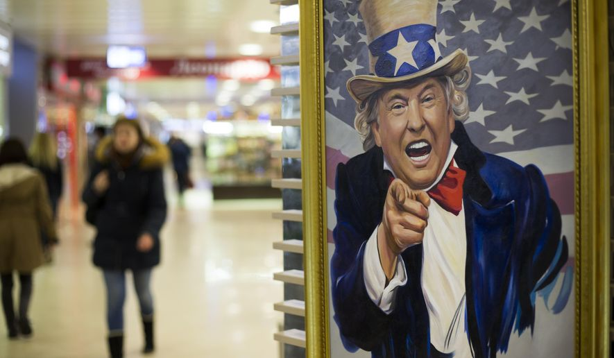 FILE- In this file photo taken on Wednesday, March 22, 2017, People walk past a caricature picture of U.S. President Donald Trump on sale in a shopping mall in Moscow, Russia.  US President Trump's new executive sanctions order signed Wednesday Sept. 12, 2018, authorizing sanctions on foreigners who mess with American elections could herald new headaches for Moscow. (AP Photo/Alexander Zemlianichenko)