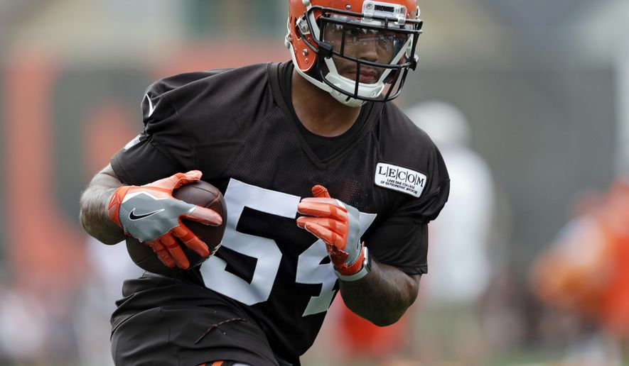 FILE - In this Friday, July 27, 2018, file photo, Cleveland Browns offensive lineman Mychal Kendricks during NFL football training camp, in Berea, Ohio. The Seattle Seahawks are expected to sign Kendricks to a one-year contract despite his recent guilty plea on insider trading charges. Two people with knowledge of the deal told The Associated Press on Thursday, Sept. 13, 2018, that Kendricks' agreement is expected to be finalized in time for him to join the Seahawks for their Week 2 Game at Chicago.(AP Photo/Tony Dejak, File)