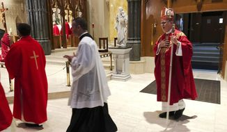 Providence diocese Bishop Thomas Tobin, right, enters the during the processional at the Cathedral of Saints Peter and Paul in Providence, R.I., Friday, Sept. 14, 2018, for a day of prayer and penance he called for due to the sex abuse scandal in the Roman Catholic Church. (AP Photo/Jennifer McDermott)