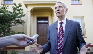 """""""We learned that schools in the United States — from kindergarten to college — have provided a level of access to the Chinese government that the Chinese government has refused to provide to the United States,"""" said Sen. Rob Portman, chairman of the investigative subcommittee. (Associated Press)"""