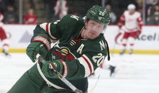 FILE- In this March 4, 2018, file photo, Minnesota Wild's Ryan Suter warms up before an NHL hockey game against the Detroit Red Wings in St. Paul, Minn. Suter returns from season-ending ankle surgery, expecting to join the Minnesota Wild for the first practice of training camp. (AP Photo/Jim Mone, File)