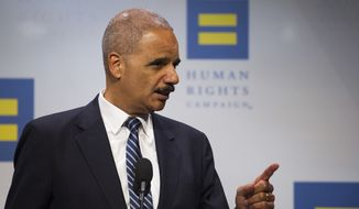 Former Attorney General Eric Holder addresses the Human Rights Campaign National Dinner in Washington, D.C., Saturday, Sept. 15, 2018. (AP Photo/Cliff Owen)